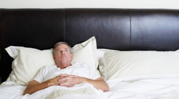 Man-Relaxing-in-Bed-670x446